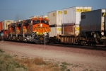 BNSF 7854 slows down to enter the BNSF Barstow yard as she passes BNSF's 7802 westbound